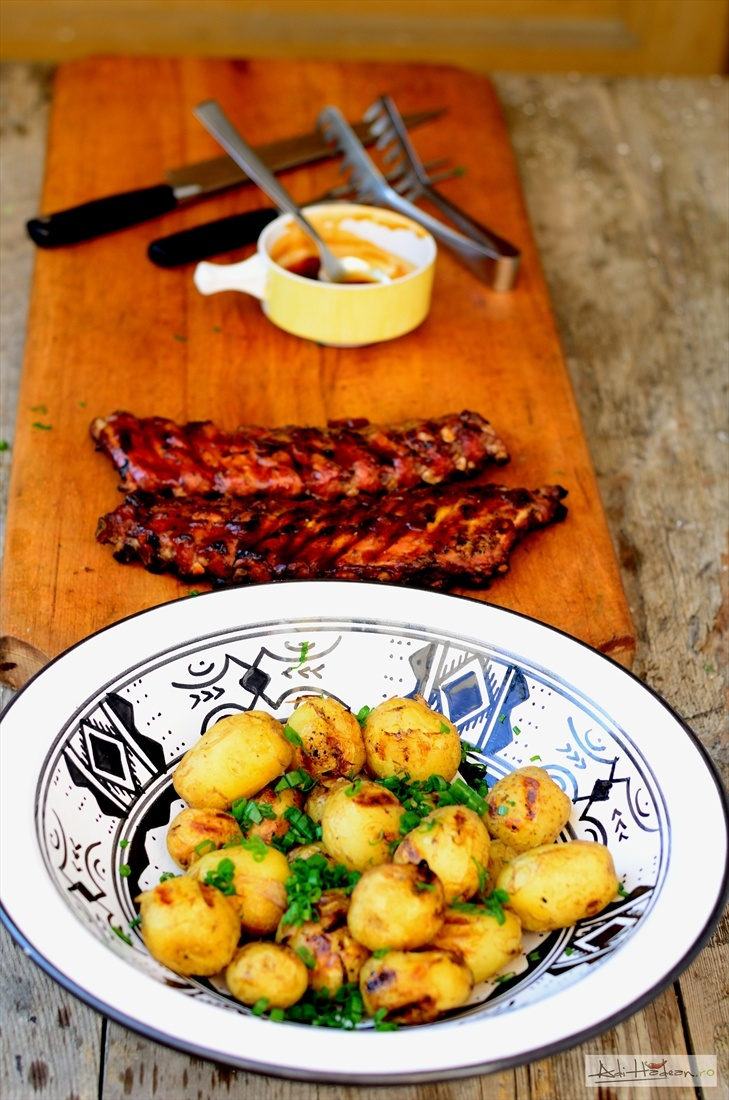 Grilled spare ribs, baked potatoes, green onions