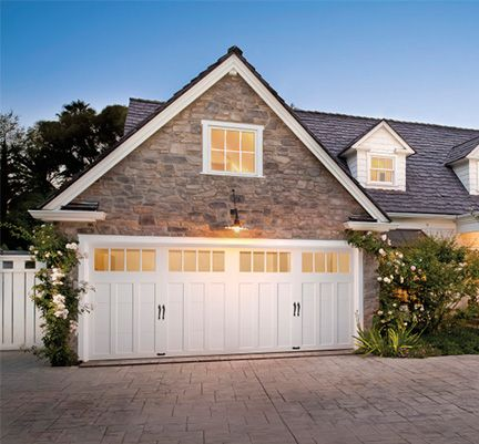 Any Home Owner's Associations in the Charlotte area are strict about what colors of garage door are allowed, but a simple white door doesn't have to be an eyesore. Here, a unique door, beautiful windows and hardware, and a simple white motif in the home's design lead to a gorgeous home. .
