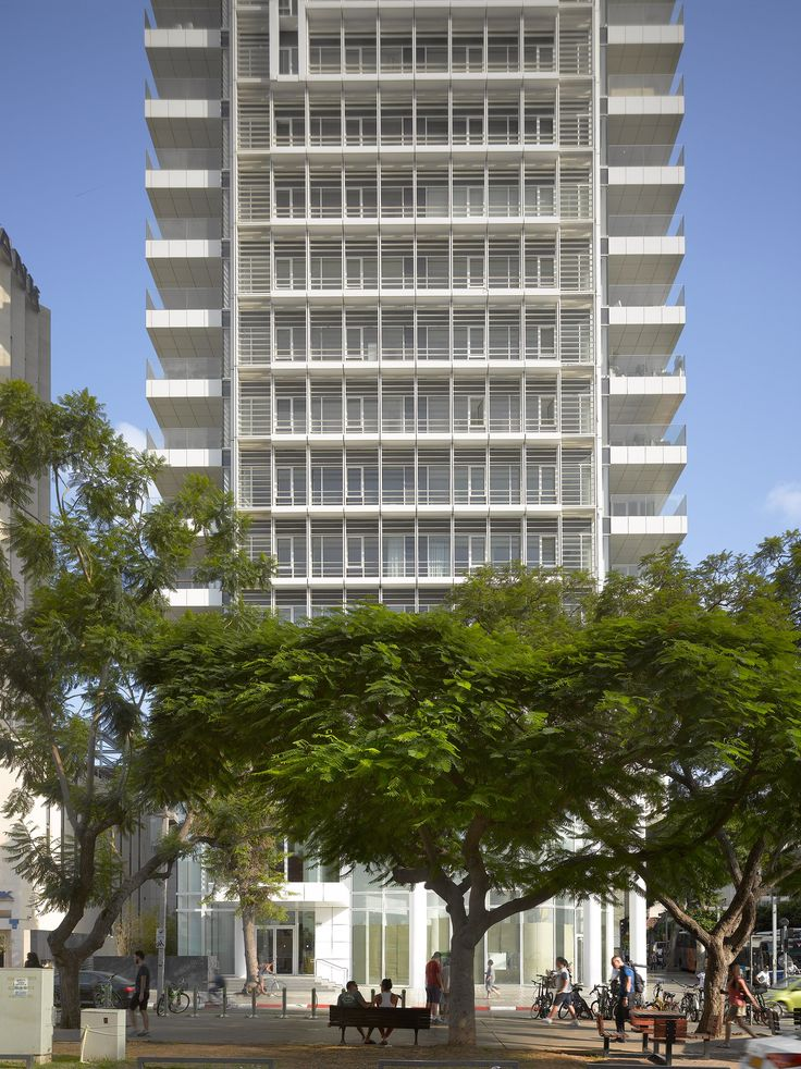 A delicate white lattice of louvres and window frames is created in front of the glazed facades, which ensure an abundance of natural light and views out towards the Mediterranean Sea for residents on the uppermost floors. Each corner of the tower is also fitted with a balcony with a white base that continues the pattern.