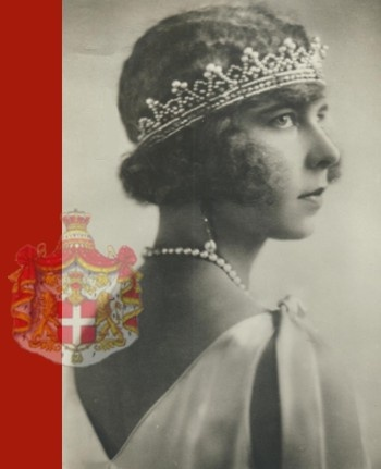 HRH Princess Maria José wearing the diamond and pearl diadem she inherited from Empress Charlotte of Mexico as a bandeau. The diadem was altered with a further part added in the back so that the Princess could wear it in the front as it was fashionable in the 1920's. The Princess wears the pearl necklace that was her engagement present from Prince Umberto and came from the collection of Queen Margherita.