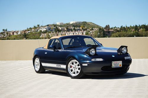 Mazda Miata STO, ROB HAS BRIGHT RED, 1990 MIATA. HE LOVES IT. I HAVE TROUBLE GETTING IN/OUT CAUSE OF MY MS!!!!