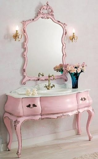 pink paint, old mirror and desk into a most unusual vanity just right for a powder room.