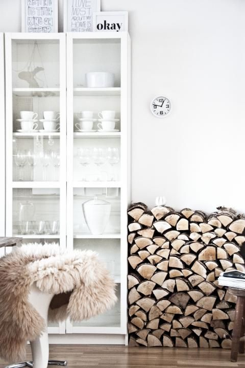 ★ I love having firewood in the house and the idea of having it in like a bookcase or built in. But maybe next to the fireplace and not my glassware.
