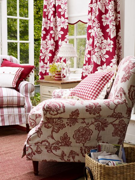 i love the use of one color plus white or cream, in a room. it allows you to use many patterns without it getting too busy. Red works just as well as blue, for this approach!
