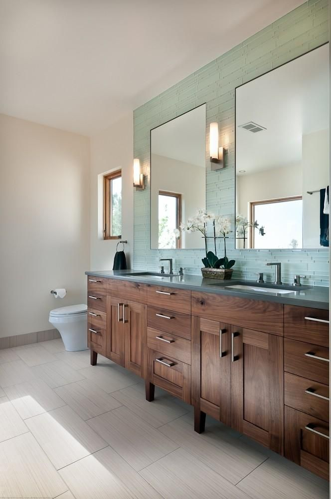 Rift sawn black walnut master bath vanity. I'm obsessed with walnut - gorgeous. Also, we have this floor tile (so obv I love it), and the glass tile on the wall with the mirrors is so pretty.