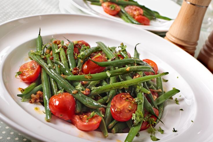 Recipe including course(s): Side; and ingredients: basil, black pepper, cherry tomato, cooking spray, garlic, green beans, salt
