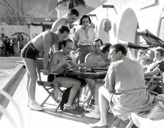 Zeppo and Harpo Marx playing backgammon at Palm Springs, California in 1933.