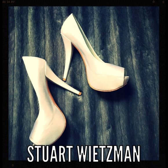 Stuart Wietzman Satin Pump Stuart Weitzman satin open toe platform pump. Like new worn 2 times with very minimal scuffing ( shown in pictures) size 6 Stuart Weitzman Shoes Platforms