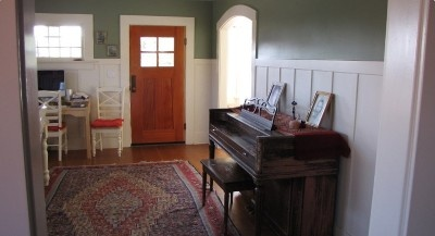 old piano in the front entrance.