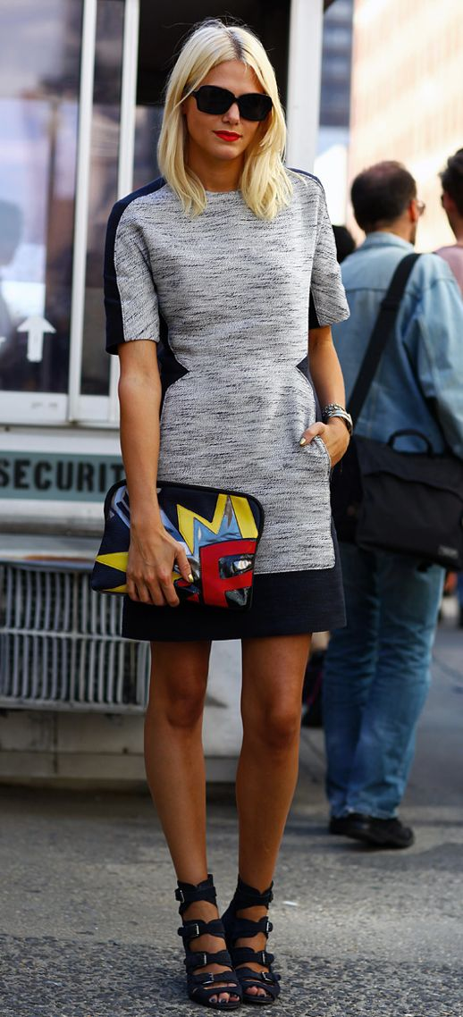 Street style grey and black dress with comics purse. This whole outfit is edgy and youthful.