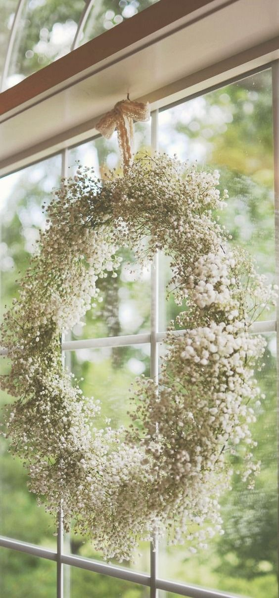 Simple baby's breath wreath hanging in the window looks lovely inside and out.