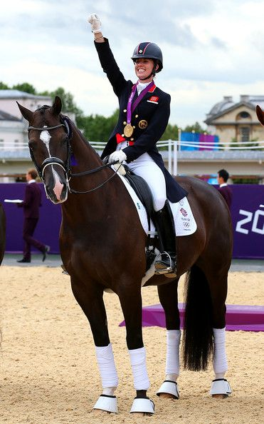 Charlotte Dujardin Photos Photos - Charlotte Dujardin of Great Britain on Valegro celebrates with her gold medal during the medal cerermony for the Team Dressage on Day 11 of the London 2012 Olympic Games at Greenwich Park on August 7, 2012 in London, England. - Olympics Day 11 - Equestrian