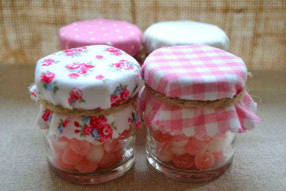 Jam Jars with pink and white candy and shabby chic covers.