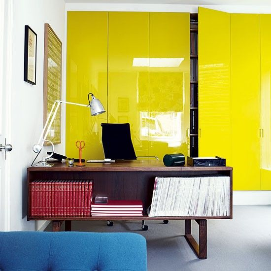Acid-yellow lacquer makes a statement out of storage in the ground-floor home office, which used to be a garage.    The vintage desk is from Two Columbia Road, and the carpet is from MD Carpets at Bill Nunn.     Photograph by Jake Curtis