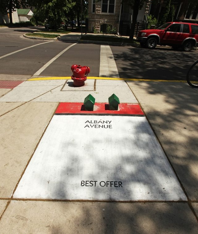 Street artist 'Bored' turns Chicago sidewalks into an alternative Monopoly game