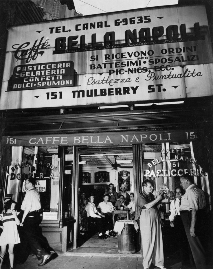 Little Italy 1944  Friends gather to talk at the Caffe Bella Napoli on Mulberry Street, Little Italy, the Italian community of New York City in 1944.
