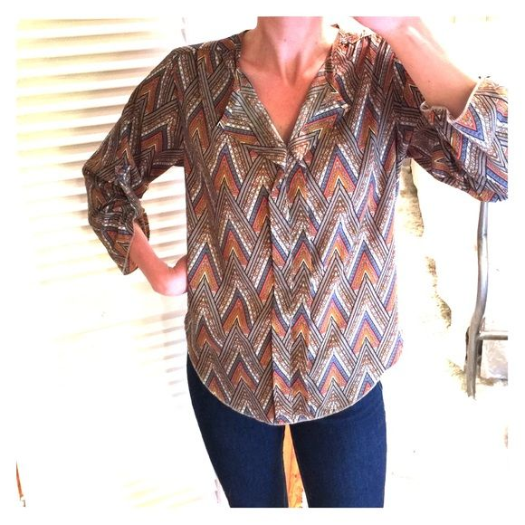 Francesca's Collections tab-sleeve Aztec blouse Worn a handful of times but in great shape. From Francesca's but specifically Blue Rain brand. Tab-sleeve allows for some versatility. I love the buttons on the sleeve. 100% polyester. Smoke and pet free home. Francesca's Collections Tops Blouses