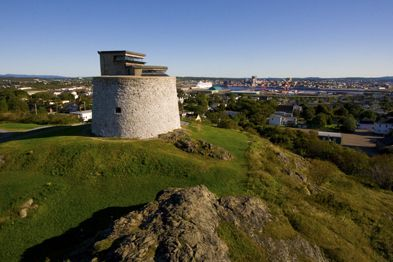 Martello Tower on a sunny day. The city of Saint John and its harbour appears in the background