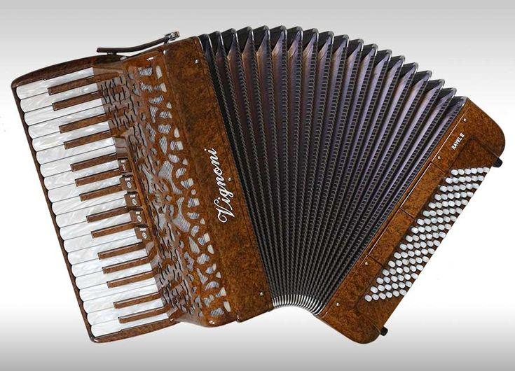 96 Bass Vignoni Ravel II piano accordion. Swing tuned. Stunning burr wood finish.  FOR SALE at  £3,185.00