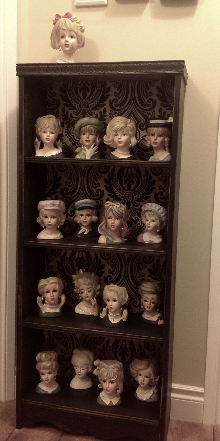 My collection of vintage lady head vases.