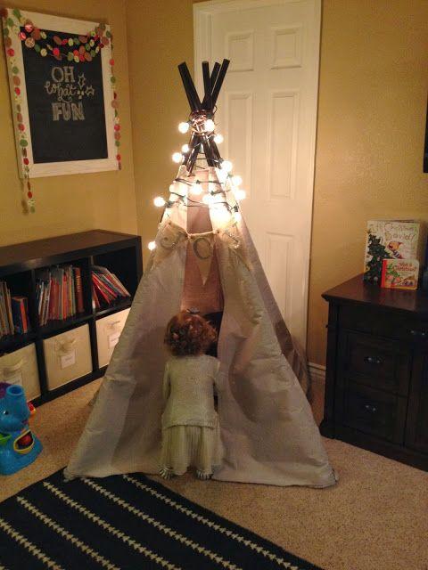 Holiday Playroom:lit teepee, chalkboard art, paper garland