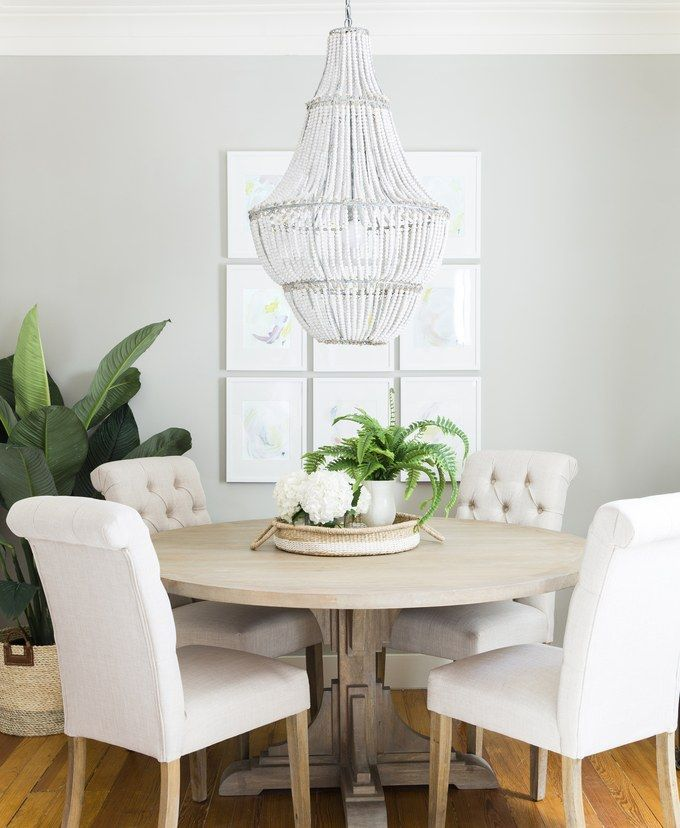 Ben Higgins and Lauren Bushnell's simple dining space with a large bead chandelier