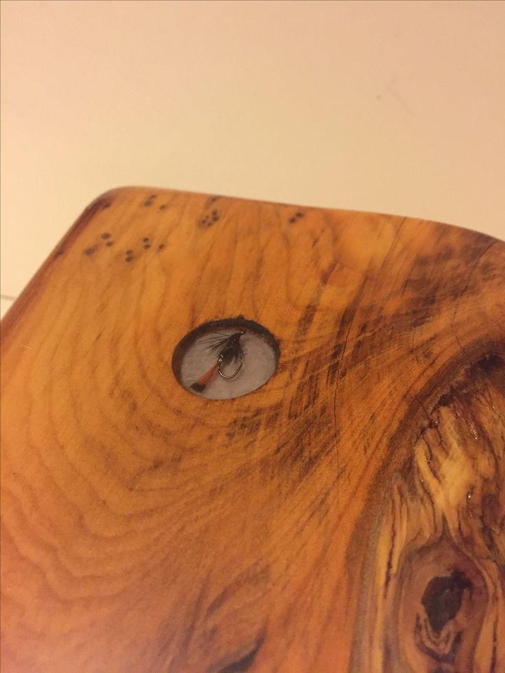 Fly cast in epoxy, embedded in yew