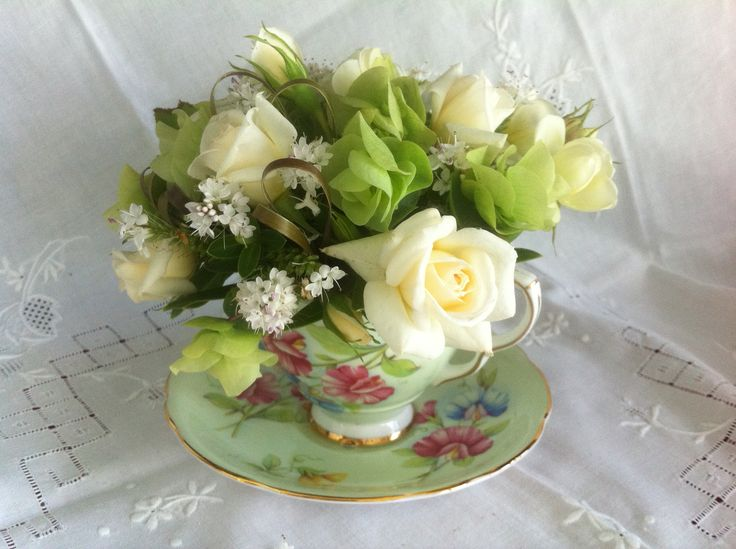 mini roses in teacups http://www.wanakaweddingflowers.co.nz/gallery/