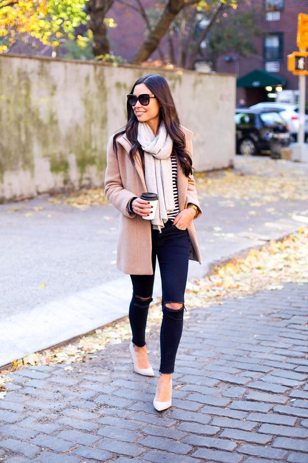 Kat Tanita of With Love From Kat wears J Brand distressed jeans with SJP by Sarah Jessica Parker grey suede pumps from Nordstrom, and a Joie sweater in NYC.