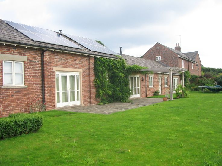 Heat Pump Case Studies: A ground source heat pump replaces LPG in a  Macclesfield barn conversion which also features solar PV.