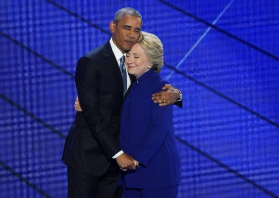 President Barack Obama and Democratic presidential nominee Hillary Clinton embrace onstage after Obama delivered a key speech on her behalf at the Democratic National Convention at Wells Fargo Center in Philadelphia on July 27, 2016.