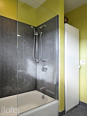 Tub Shower With Tiled Wall And Gl Splash Guard