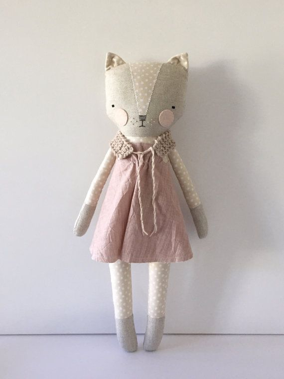 Luckyjuju dolls are handmade from new and vintage fabrics, felt, lace, ribbon, yarn and polyfill stuffing. The face is hand embroidered with floss.