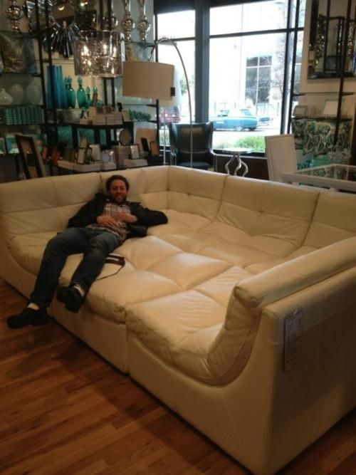 Giant Couch for Lounging, Bromantic Sleepovers, Etc.   32 Things You Need In Your Man Cave