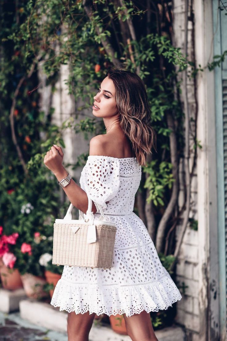 Off the shoulder white eyelet mini dress + Prada basket tote bag