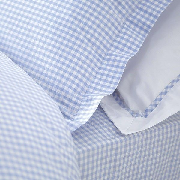 Always appealing; baby blue gingham. Note the gingham trim on the shams!