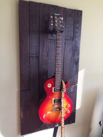 Guitar wall display rack made from up cycled wood by RusticYears