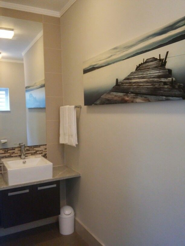 Bathroom art inexpensive canvas double up when reflected in mirror  apartment revamp