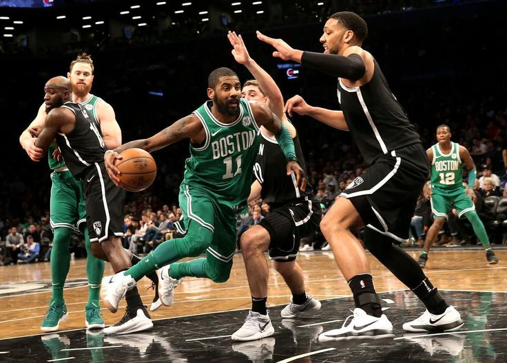 Mandatory Credit: Photo by PETER FOLEY/EPA-EFE/REX/Shutterstock (9309063c) Kyrie Irving and Kahlil Okafor Boston Celtics at Brooklyn Nets, New York, USA - 06 Jan 2018 Boston Celtic guard Kyrie Irving (C) dribbles around Brooklyn Net forward Kahlil Okafor (R) in the first half of their NBA basketball game at Barclays Center in Brooklyn, New York, USA, 06 January 2018.