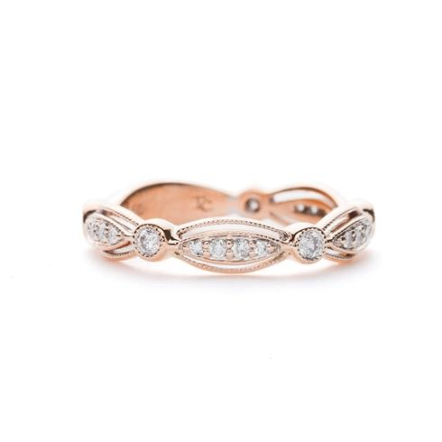Featuring alternating marquis-shaped and round pave diamond clusters bordered by milgrain, this stunning rose gold band is perfect as a wedding band or simply for daily wear.  Greenwich Collection at Greenwich Jewelers  $1285