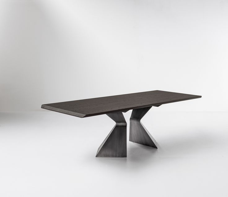 """The """"gritty"""" business man lives in a loft in Milan. For his house he has chosen AX with walnut top and pickled finish metal base: a bold, unusual, gritty choice. Metals such as steel, brass, copper, corten can make a home original and unique. In combination with more traditional materials, such as wood, it may be a valid solution for those looking for a classy yet warm and lively style. Here are some ideas to give a gritty touch to your home. #bonaldo #adv #AX #metal #gritty"""