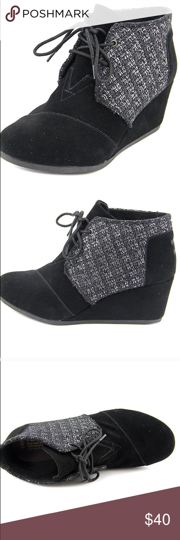 Toms Desert Wedge Booties - Black and silver Excellent (like new) condition Desert Wedge booties by toms. I don't know if these have actually ever been worn or not. I believe they were only tried on. Regardless, these are in perfect condition and have the cutest subtle silver design on the back half of the shoes. If you have any other toms, you already know how comfortable these boots are! Get them at this hot off season price while you can! Let me know if you have any questions! TOMS Shoes…