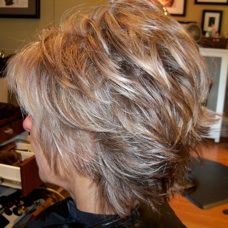 Photos of real hair behind the chair with a brief description of color, cut, and type of hair.