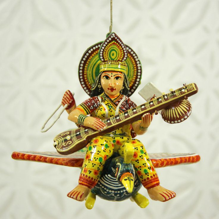 Colourful wooden Goddess Saraswathi in flight on her vahana, crafted by artisans in Benares