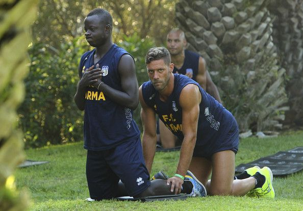Cibsah Yussif Raman and Andrea Rispoli of Parma FC train during Parma FC Pre-Season Training Session at Rosa Marina Resort on July 8, 2013 in Ostuni, Italy.