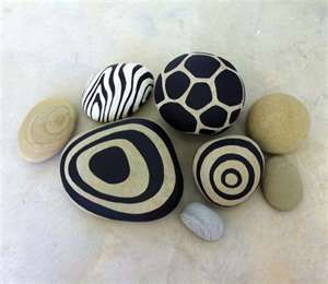 natural and animal prints painted on river rocks, stones and pebbles. concentric