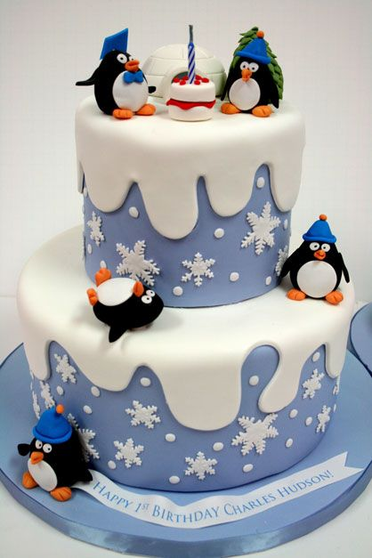 Snowflakes and a Penguins 1st birthday cake...like the little birthday cake between the Penquins.