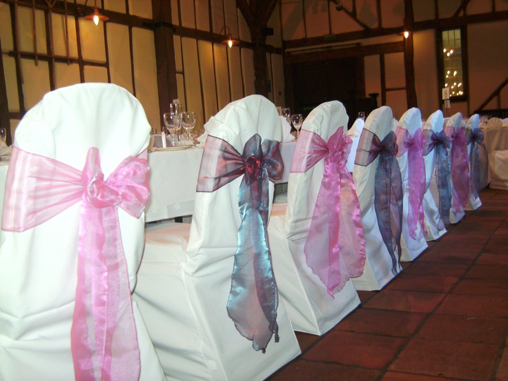 Alternating Sparkle Pink and Heather Organza Bows on White Chair Covers