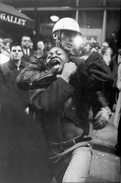 "One of high school student Taylor Washington's numerous arrests is immortalized as he yells while passing before me. The photograph became the cover of SNCC's photo book, The Movement, and was reproduced in the former Soviet Union in Pravda, captioned ""Police Brutality USA."""