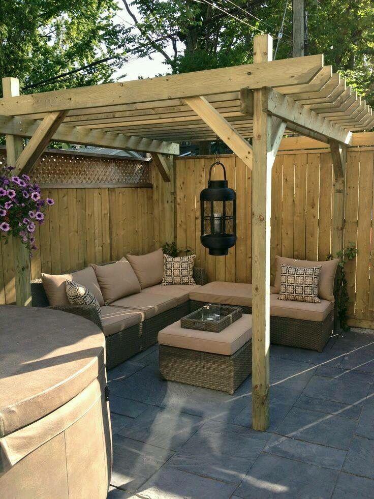 Terraza con pergola en madera, muy acogedora